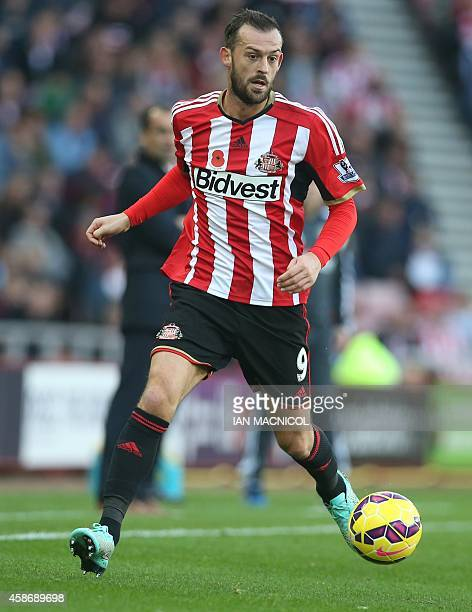 Sunderland's Englishborn Scottish striker Steven Fletcher controls the ball during the English Premier League football match between Sunderland and...