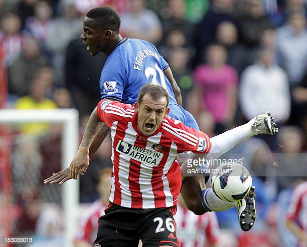Sunderland's Englishborn Scottish striker Steven Fletcher vies with Wigan's Honduran defender Maynor Figueroa during the English Premier League...