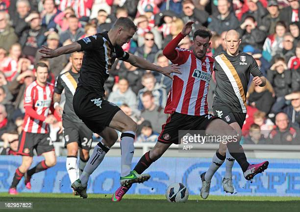 Sunderland's Englishborn Scottish striker Steven Fletcher vies with Fulham's Norwegian defender Brede Hangeland during the English Premier League...