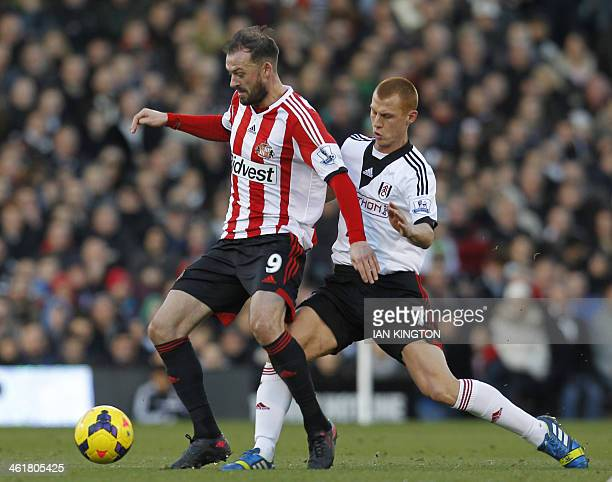 Sunderland's Englishborn Scottish striker Steven Fletcher vies with Fulham's English midfielder Steve Sidwell during the English Premier League...