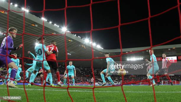 Sunderland's first goal goes in off Kelland Watts of Newcastle during the Checkatrade trophy match between Sunderland and Newcastle United U21 at...