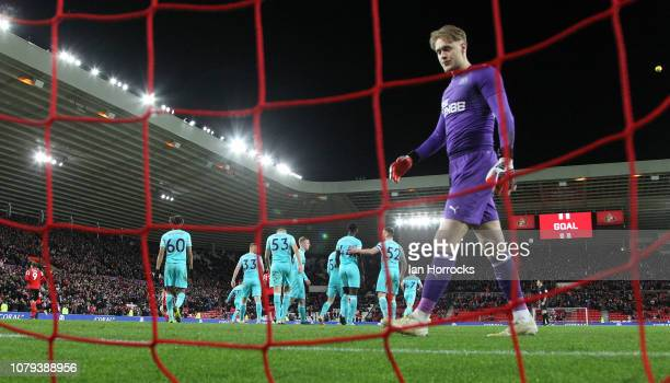 Sunderland's first goal goes in off Kelland Watts of Newcastle who is consoled by teammates during the Checkatrade trophy match between Sunderland...