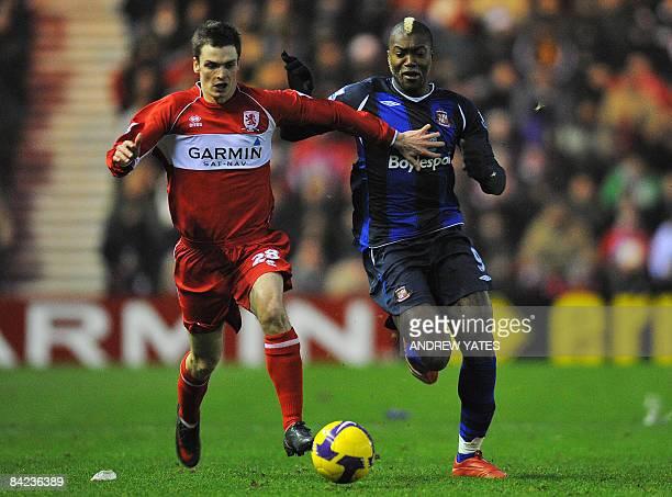 Sunderland's French forward Djibril Cissé vies with Middlesbrough's English midfielder Adam Johnson during the English Premier league football match...