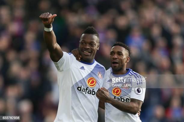 Sunderland's Frenchborn Ivorian defender Lamine Kone celebrates with Sunderland's English striker Jermain Defoe after scoring the opening goal during...