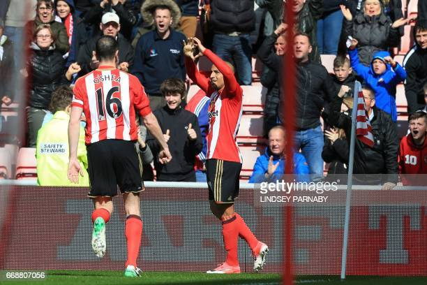 Sunderland's Frenchborn Tunisian midfielder Wahbi Khazri celebrates his opening goal with Sunderland's Irish defender John O'Shea during the English...