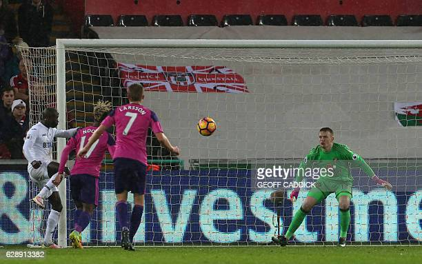 Sunderland's Gabonese midfielder Didier N'Dong has a shot on goal during the English Premier League football match between Swansea City and...