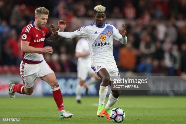 Sunderland's Gabonese midfielder Didier N'Dong vies with Middlesbrough's English midfielder Adam Clayton during the English Premier League football...