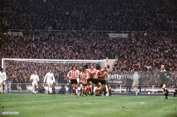 Sunderland's Ian Porterfield is congratulated on scoring the winning goal by teammates Vic Halom Bobby Kerr Billy Hughes Ron Guthrie Richie Pitt...