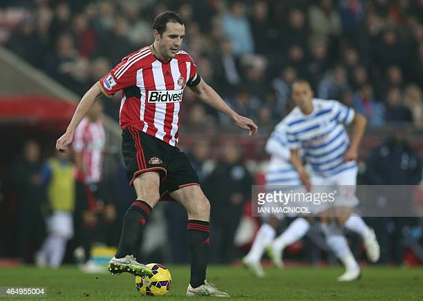 Sunderland's Irish defender John O'Shea plays the ball during the English Premier League football match between Sunderland and Queens Park Rangers at...