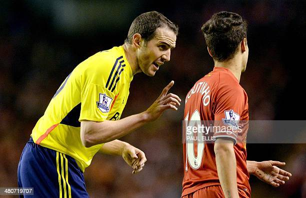 Sunderland's Irish defender John O'Shea speaks to Liverpool's Brazilian midfielder Philippe Coutinho after Coutinho claimed to have been fouled...