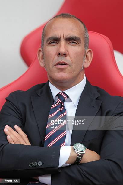 Sunderland's Italian manager Paolo Di Canio takes his seat during the English Premier League football match between Sunderland and Fulham at the...