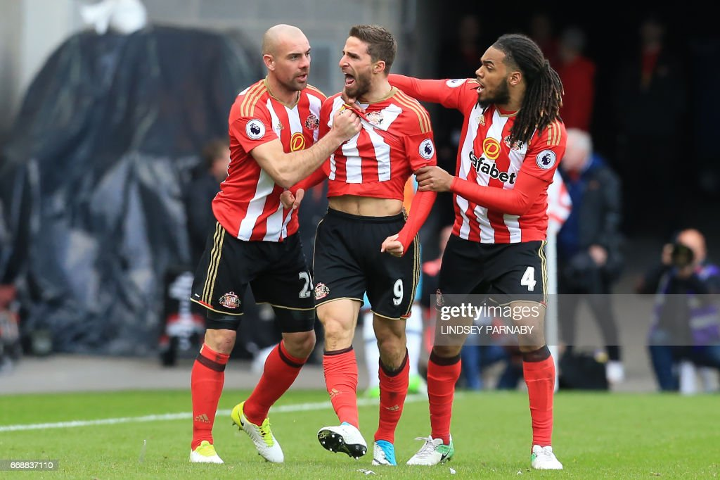 Sunderland's Italian striker Fabio Borini (C) celebrates scoring their second goal with Sunderland's Irish midfielder Darron Gibson (L) and Sunderland's Dutch defender Jason Denayer during the English Premier League football match between Sunderland and West Ham United at the Stadium of Light in Sunderland, north-east England on April 15, 2017. / AFP PHOTO / Lindsey PARNABY / RESTRICTED TO EDITORIAL USE. No use with unauthorized audio, video, data, fixture lists, club/league logos or 'live' services. Online in-match use limited to 75 images, no video emulation. No use in betting, games or single club/league/player publications. /