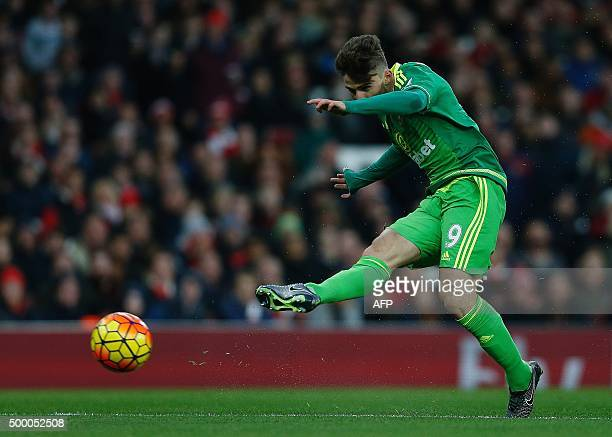 Sunderland's Italian striker Fabio Borini shoots but is saved by Arsenal's Czech goalkeeper Petr Cech during of the English Premier League football...