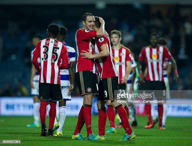 Sunderland's John O'Shea congratulates double goal scorer Paddy McNair at the final whistle during the EFL Cup Third Round match between Queens Park...