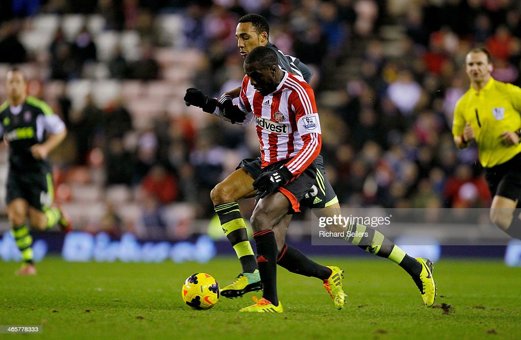 Sunderland's Jozy Altidore and Stoke's Geoff Cameron challenge during the Barclays Premier League match between Sunderland and Stoke City at Stadium of Light on January 29, 2014 in Sunderland, England.