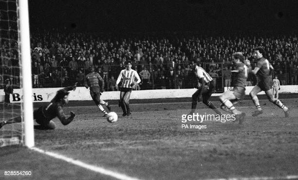 Sunderland's keeper Chris Turner leaps but the ball goes wide from the boot of Chelsea's Paul Canoville during a Chelsea attack during the Milk Cup...