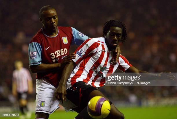Sunderland's Kenwyne Jones and Aston Villa's Nigel ReoCoker battle for the ball