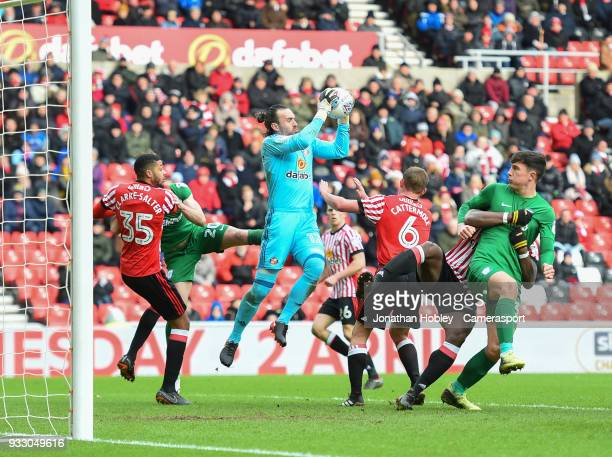 Sunderland's Lee Camp makes the ball safe with Jake ClarkeSalter defending during the Sky Bet Championship match between Sunderland and Preston North...