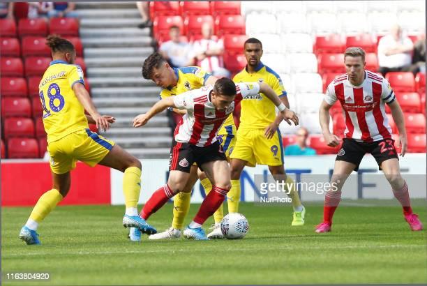 Sunderland's Lynden Gooch competes for the ball with AFC Wimbledon's Nesta Guinnes-Walker during the Sky Bet League 1 match between Sunderland and...
