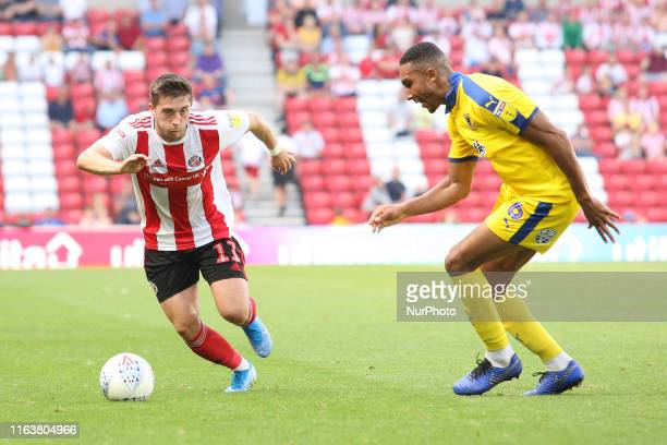 Sunderland's Lynden Gooch competes for the ball with AFC Wimbledon's Terell Thomas during the Sky Bet League 1 match between Sunderland and AFC...