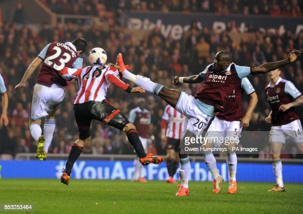 Sunderland's Marcus Alonso is challenged by West Ham's Guy Demel during the Barclays Premier League match at the Stadium of Light Sunderland