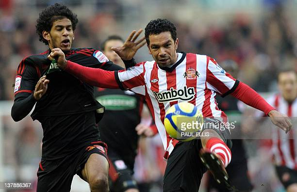 Sunderland's midfielder Kieran Richardson and Middlesbrough's Belgian midfielder Faris Haroun fight for the ball during their English FA Cup football...