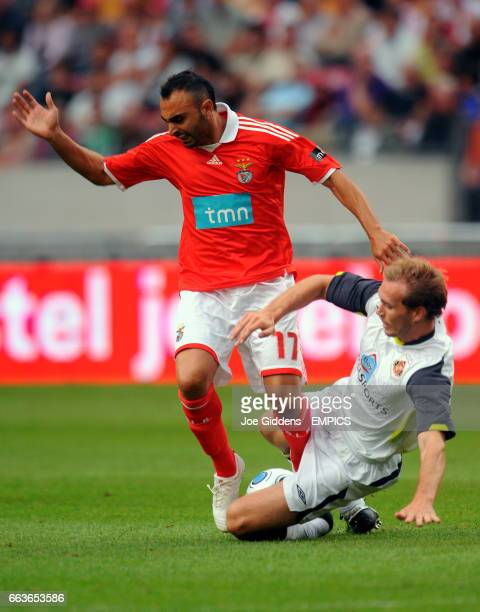 Sunderland's Russell Anderson and Benfica's Carlos Martins