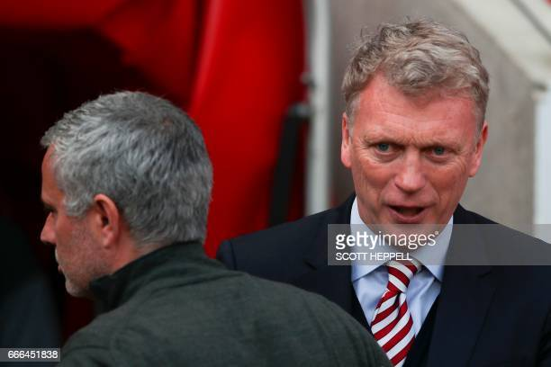 Sunderland's Scottish manager David Moyes greets Manchester United's Portuguese manager Jose Mourinho ahead of the English Premier League football...