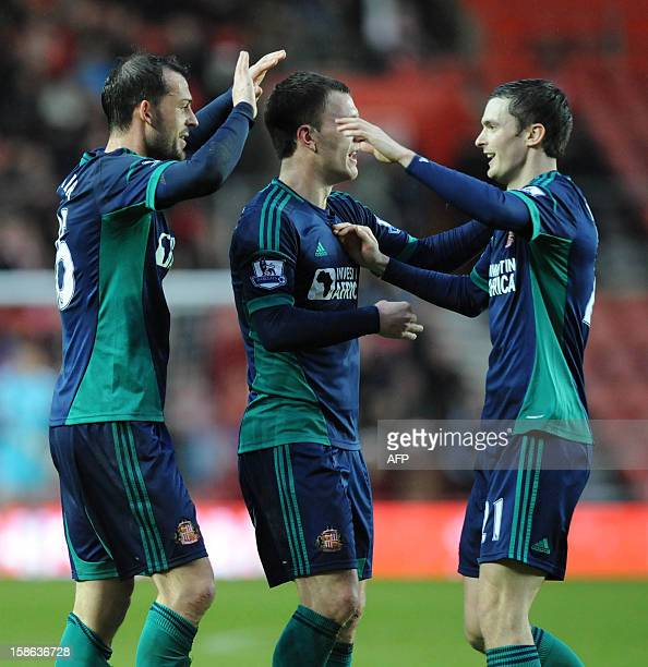 Sunderland's Scottish striker Steven Fletcher celebrates scoring the opening goal with English midfielders Craig Gardner and Adam Johnson during the...