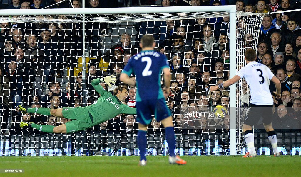 """Sunderland's Spanish defender Carlos Cuellar (not seen) scores a goal past Fulham's Australian goalkeeper Mark Schwarzer (L) during the English Premier League football match between Fulham and Sunderland at Craven Cottage in London on November 18, 2012. USE. No use with unauthorized audio, video, data, fixture lists, club/league logos or """"live"""" services. Online in-match use limited to 45 images, no video emulation. No use in betting, games or single club/league/player publications."""