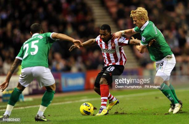 Sunderland's Stepanane Sessegon in action with Norwichs Kyle Naughton and Zak Whitbread during the Barclays Premier League match at the Stadium of...