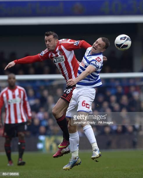 Sunderland's Steven Fletcher and Queens Park Rangers' Clint Hill battle for the ball
