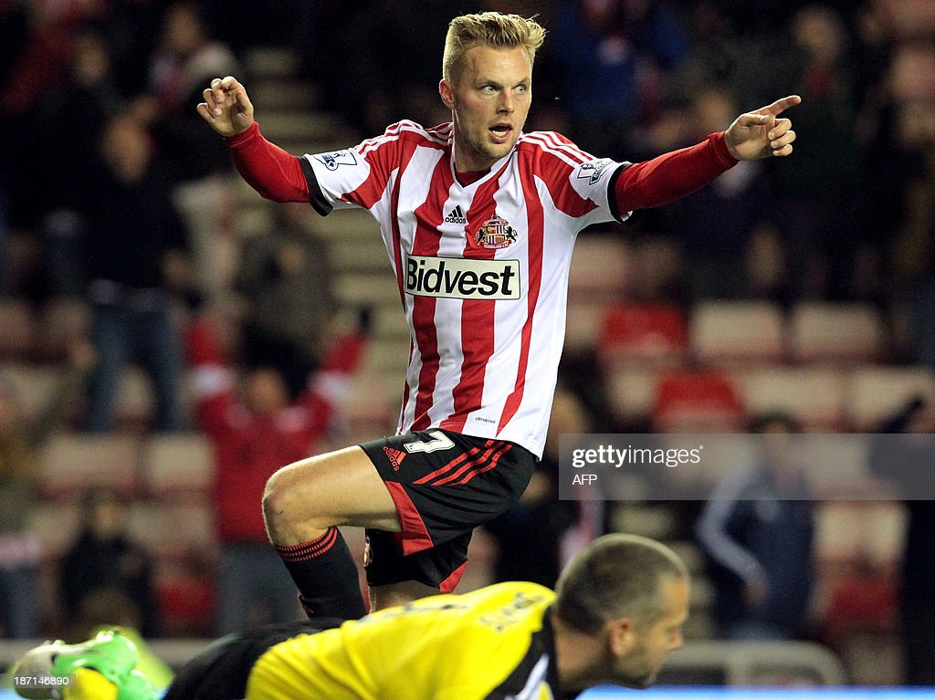 Sunderland's Swedish midfielder Sebastian Larsson celebrates scoring his team's second goal during the English League Cup football match between Sunderland AFC and Southampton FC at the Stadium of Light in Sunderland, northern England, on November 6, 2013.