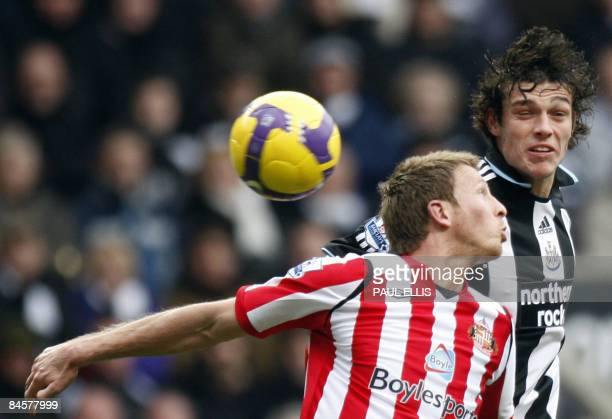 Sunderland's Welsh defender Danny Collins jumps with Newcastle United's English forward Andy Carroll during their English Premier League football...