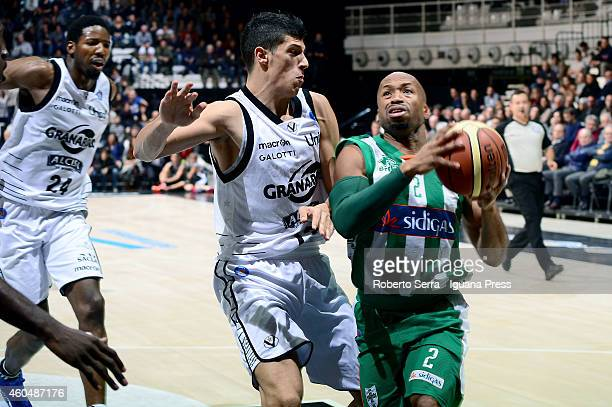 Sundiata Gaines of Sidigas competes with Simone Fontecchio of Granarolo during the LegaBasket serie A1 match between Virtus Granarolo Bologna and...