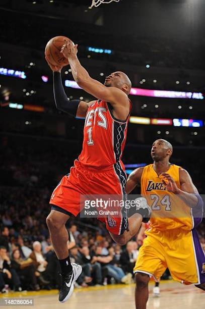 Sundiata Gaines of the New Jersey Nets drives to the basket against the Los Angeles Lakers during the game at Staples Center on April 3 2012 in Los...