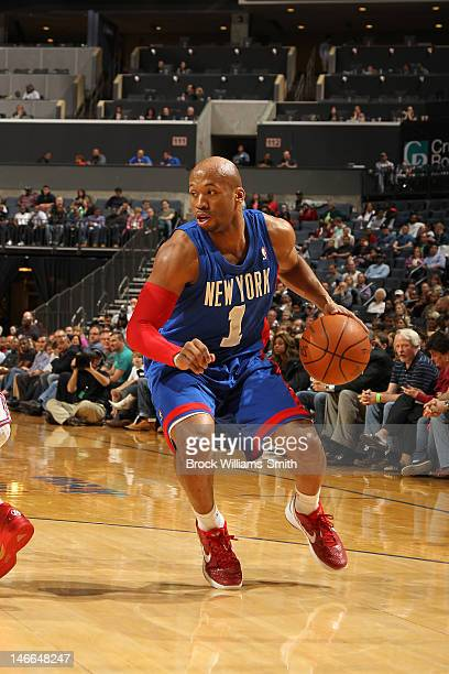 Sundiata Gaines of the New Jersey Nets moves the ball against the Charlotte Bobcats during the game at the Time Warner Cable Arena on March 9 2012 in...