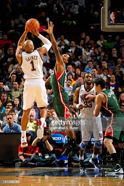 Sundiata Gaines of the New Jersey Nets shoots against Brandon Jennings of the Milwaukee Bucks on March 12 2012 at the Prudential Center in Newark New...