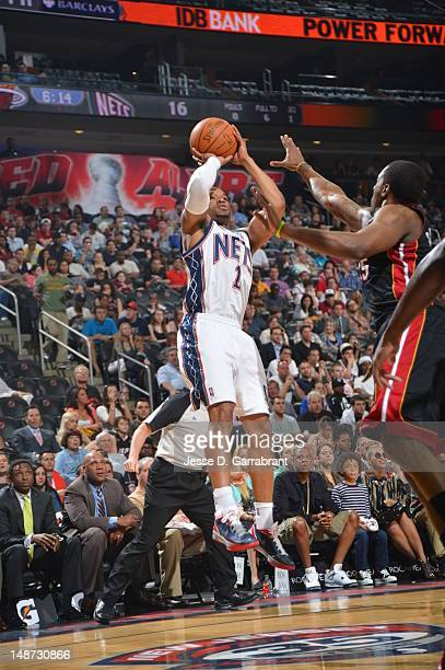 Sundiata Gaines of the New Jersey Nets shoots the ball against the Miami Heat during the game on April 16 2012 at the Prudential Center in Newark New...
