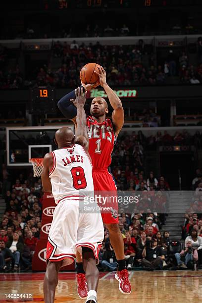 Sundiata Gaines of the New Jersey Nets takes a shot past Mike James of the Chicago Bulls during the game on February 18 2012 at the United Center in...