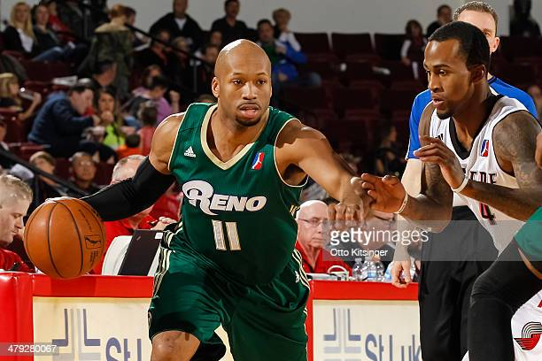 Sundiata Gaines of the Reno Bighorns moves the ball past Dee Bost of the Idaho Stampede during an NBA DLeague game on March 15 2014 at CenturyLink...