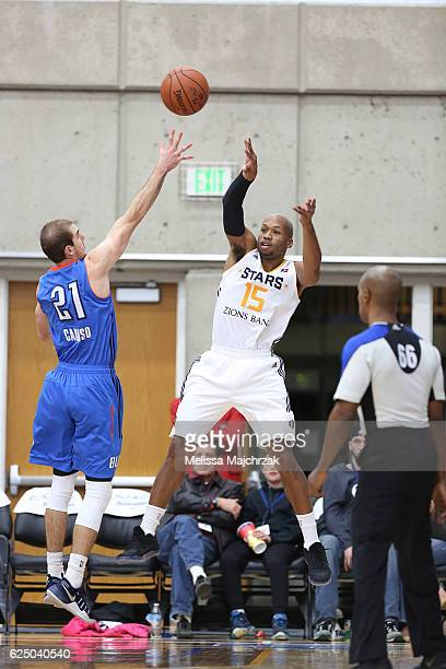 Sundiata Gaines of the Salt Lake City Stars passes the ball over Alex Caruso of the Oklahoma City Blue at Bruins Arena on November 21 2016 in...