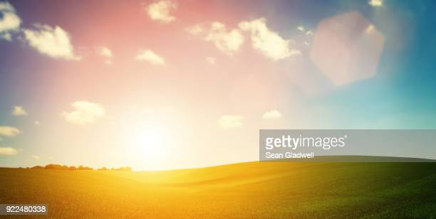sundown over hills - lens flare stock pictures, royalty-free photos & images