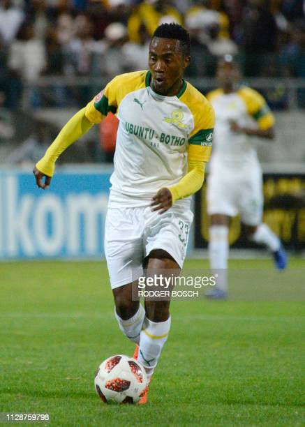 Sundown's forward Lebohang Maboe runs with the ball during the Premier Soccer League football match between Mamelodi Sundowns and Cape Town City, on...