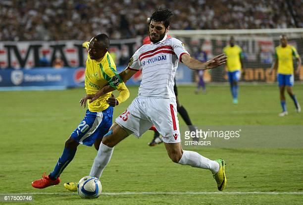 Sundowns' midfielder Khama Billiat and Zamalek's defender Ali Mossad vie for the the ball during the CAF Champions League final football match...