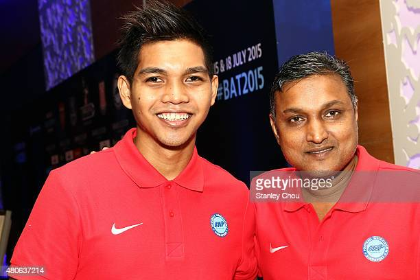 Sundramoorthy coach of Singapore and Izwan Mahbud poses during the prematch press conference ahead of the match between Arsenal and Singapore of the...