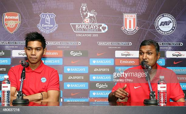 Sundramoorthy coach of Singapore speaks while Izwan Mahbud looks on during the prematch press conference ahead of the match between Arsenal and...