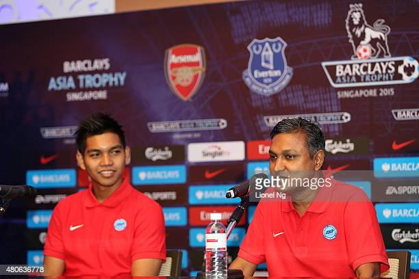 Sundramoorthy manager of Singapore Select XI speaks as Izwan Mahbud looks on during the Barclays Asia Trophy Press Conference at Grand Hyatt Hotel on...
