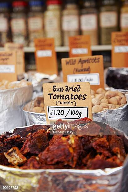 sun-dried tomatoes on market stall - richard drury stock pictures, royalty-free photos & images