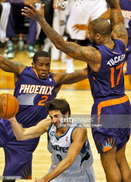 Sunds Eric Bledsoe and P. J. Tucker defended against Wolves Ricky Rubio as he drove to the basket. ] Minnesota Timberwolves vs. Phoenix Suns. Suns...